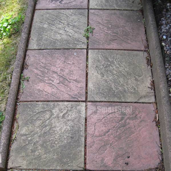 Coloured patio slabs uncleaned