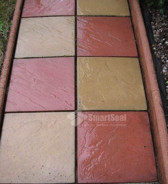 Freshly cleaned coloured patio slabs